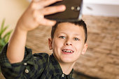 Young Boy Taking Selfie and Smiling