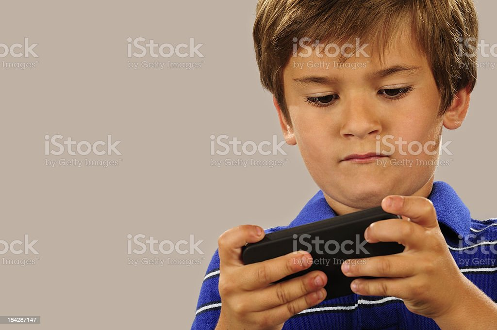 Young boy texting stock photo