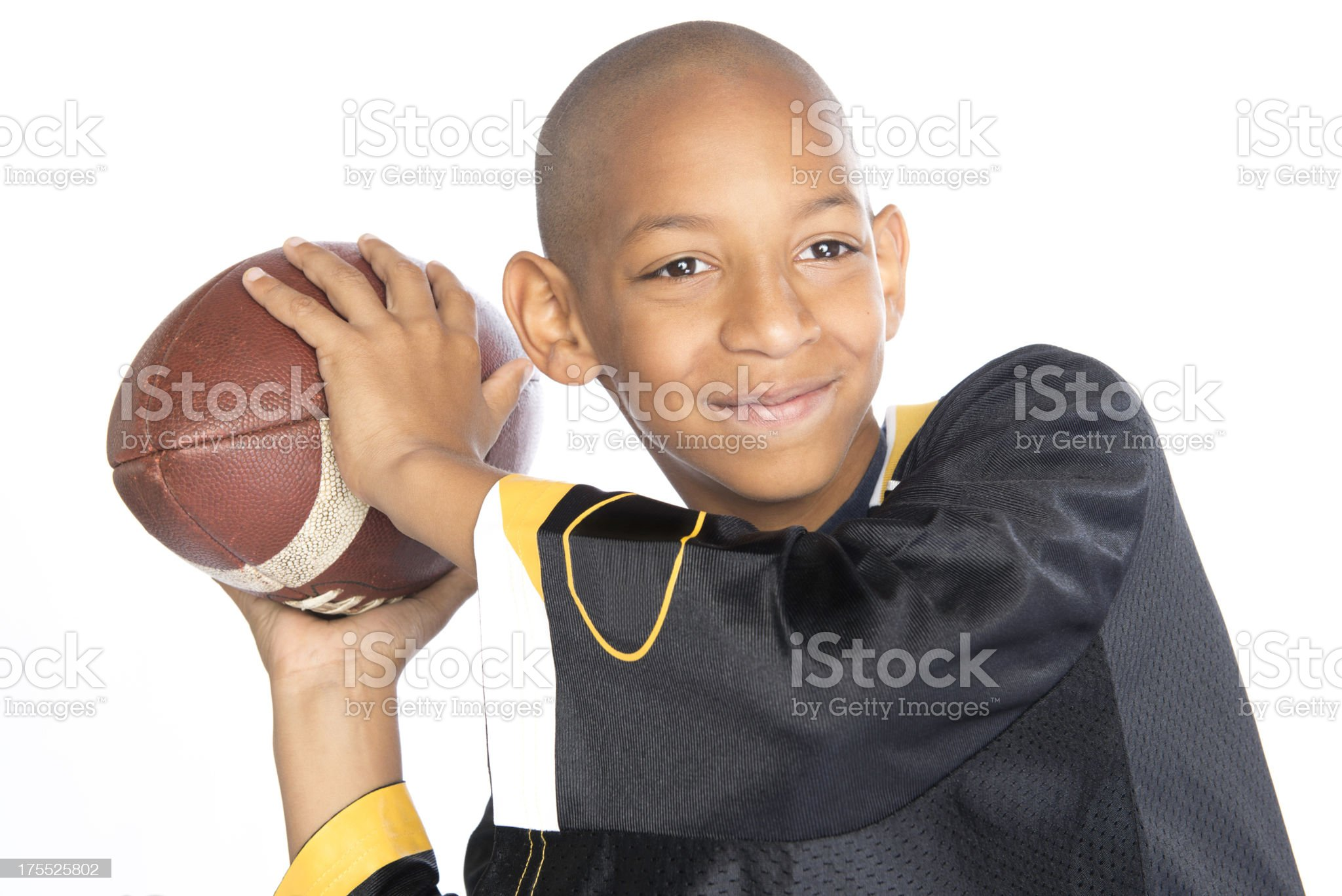 Young boy throwing a football royalty-free stock photo