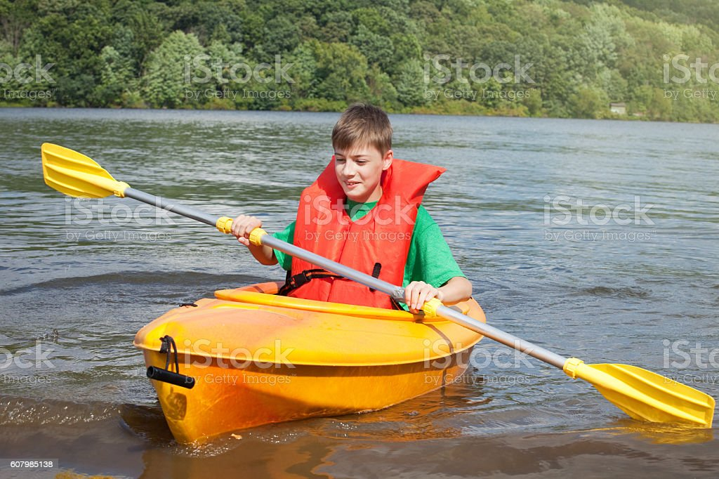 Young Boy Trying Kayaking stock photo