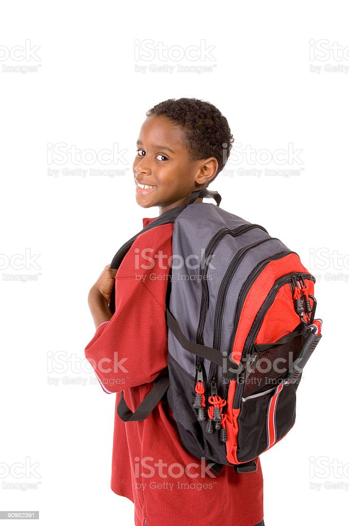 Young boy turning to camera wearing a big backpack royalty-free stock photo