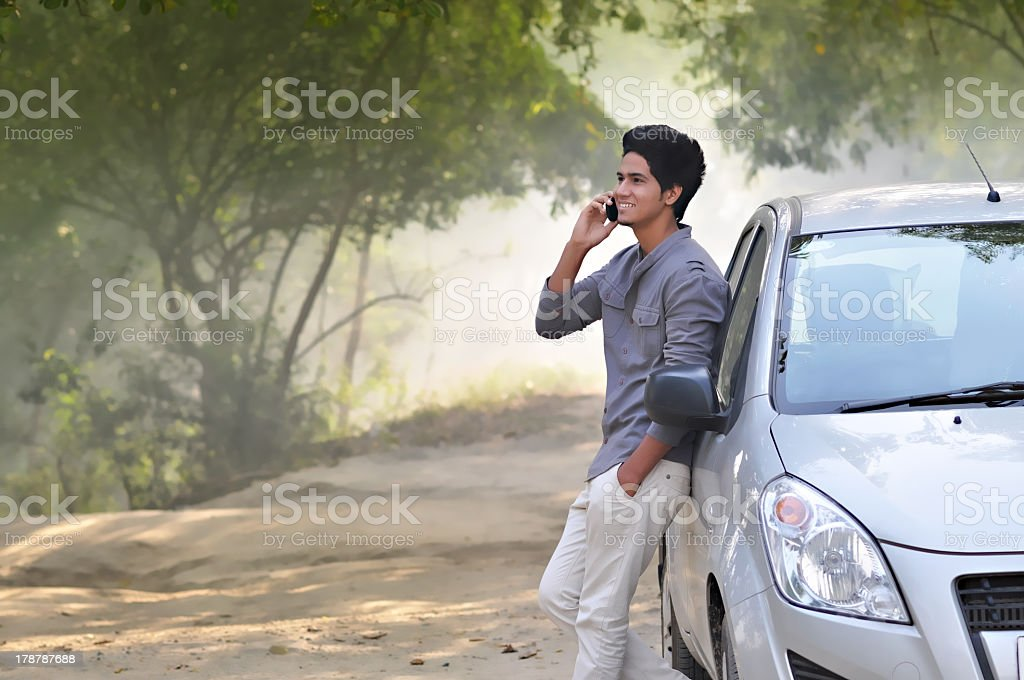 Young boy using cellphone in the forest stock photo