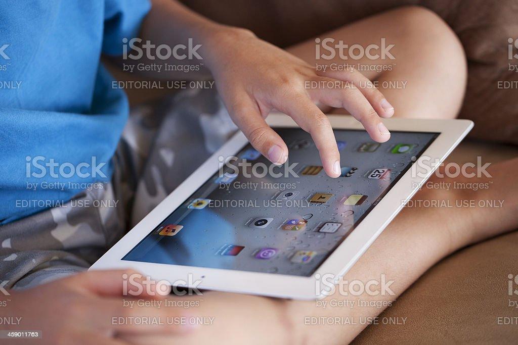 Young Boy Using iPad royalty-free stock photo