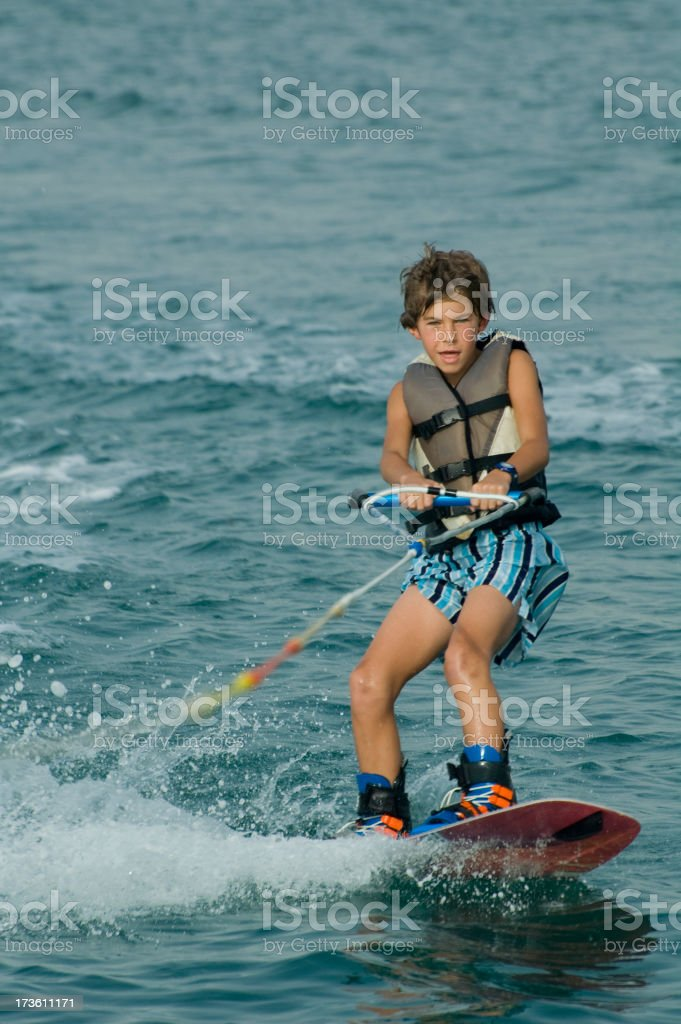 young boy wakeboarding royalty-free stock photo