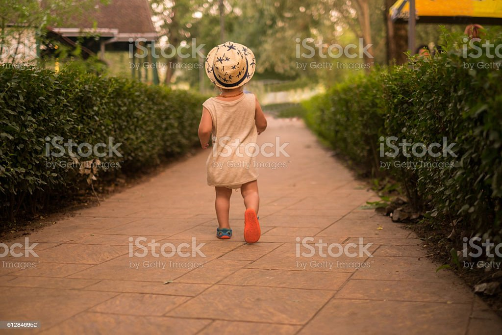 young boy walk stock photo