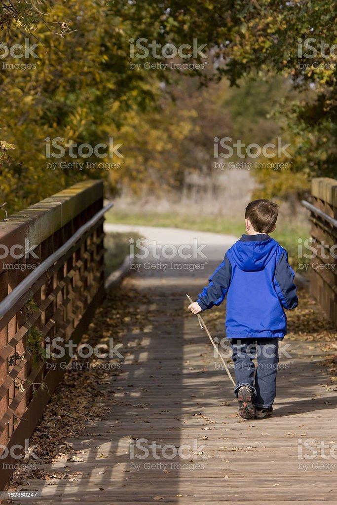 Young Boy Walking Across stock photo