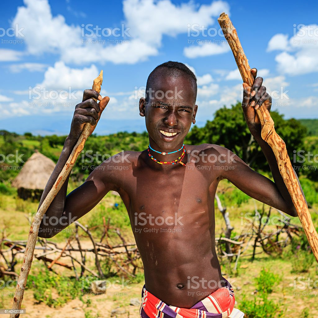 Young boy walking on stilts, Ethiopia, Africa stock photo