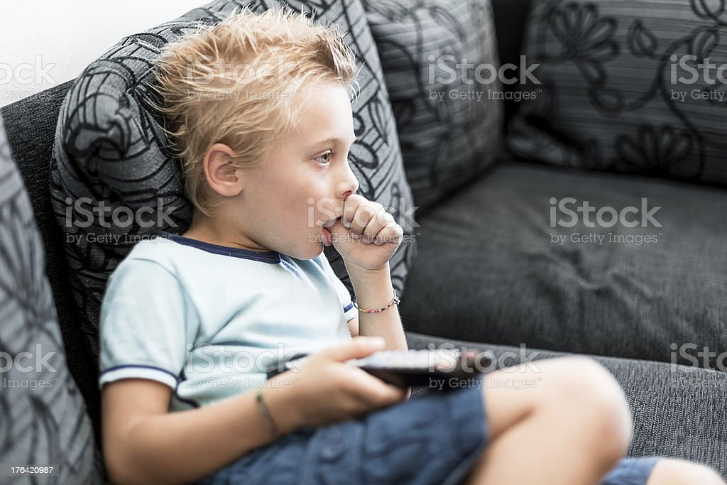 Young boy wasting time watching TV royalty-free stock photo