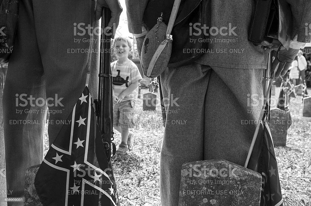 Boy smiling at soldiers on Confederate Memorial Day stock photo