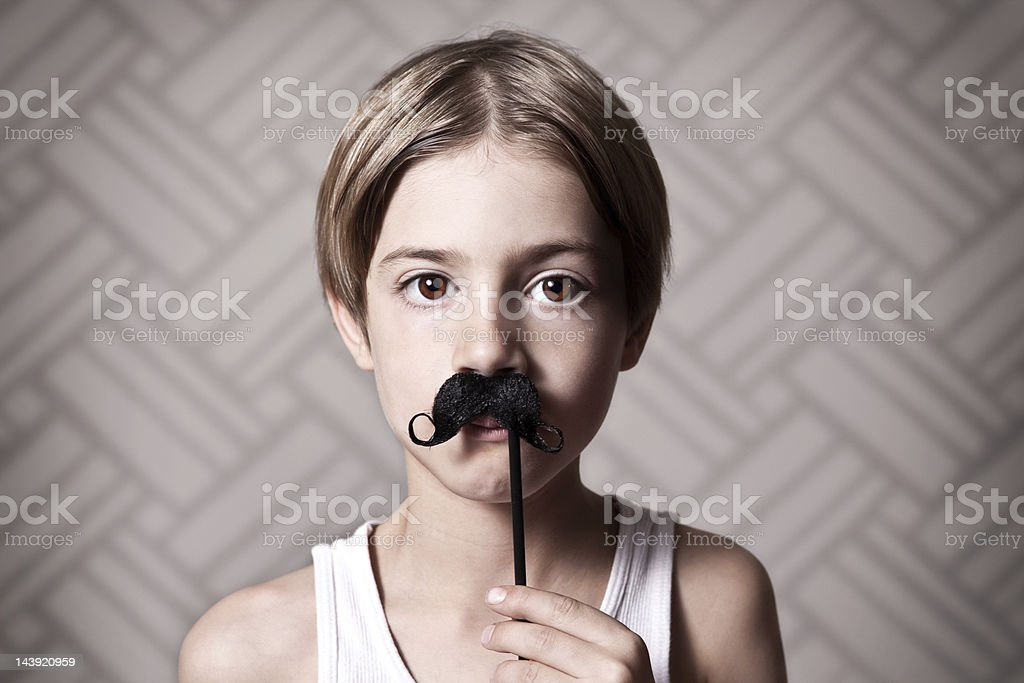 Young Boy Wearing a Mustache royalty-free stock photo