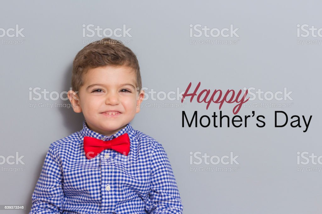 Young Boy Wearing Bow Tie Smiling stock photo