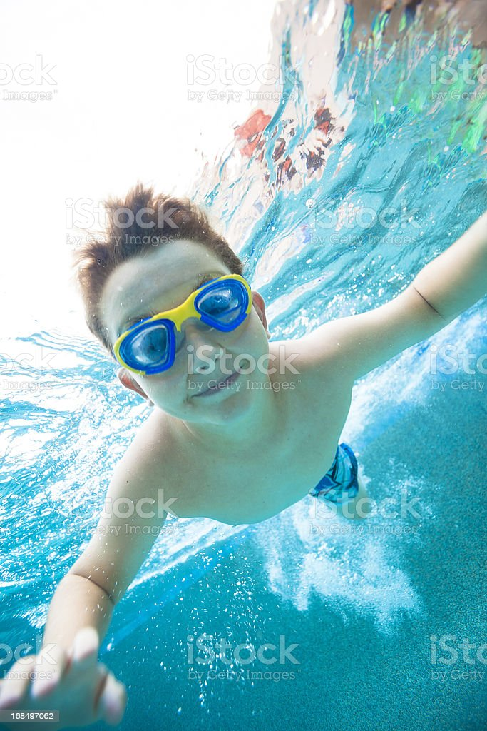 Young boy wearing goggles underwater royalty-free stock photo