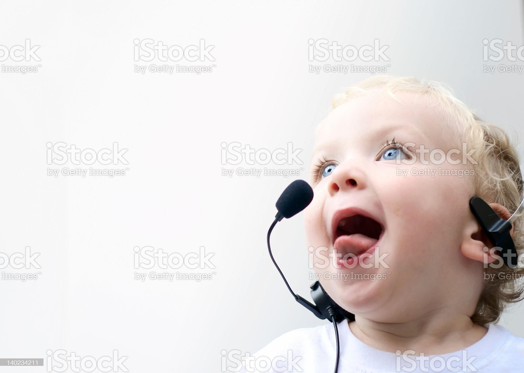 Young boy wearing phone headset royalty-free stock photo