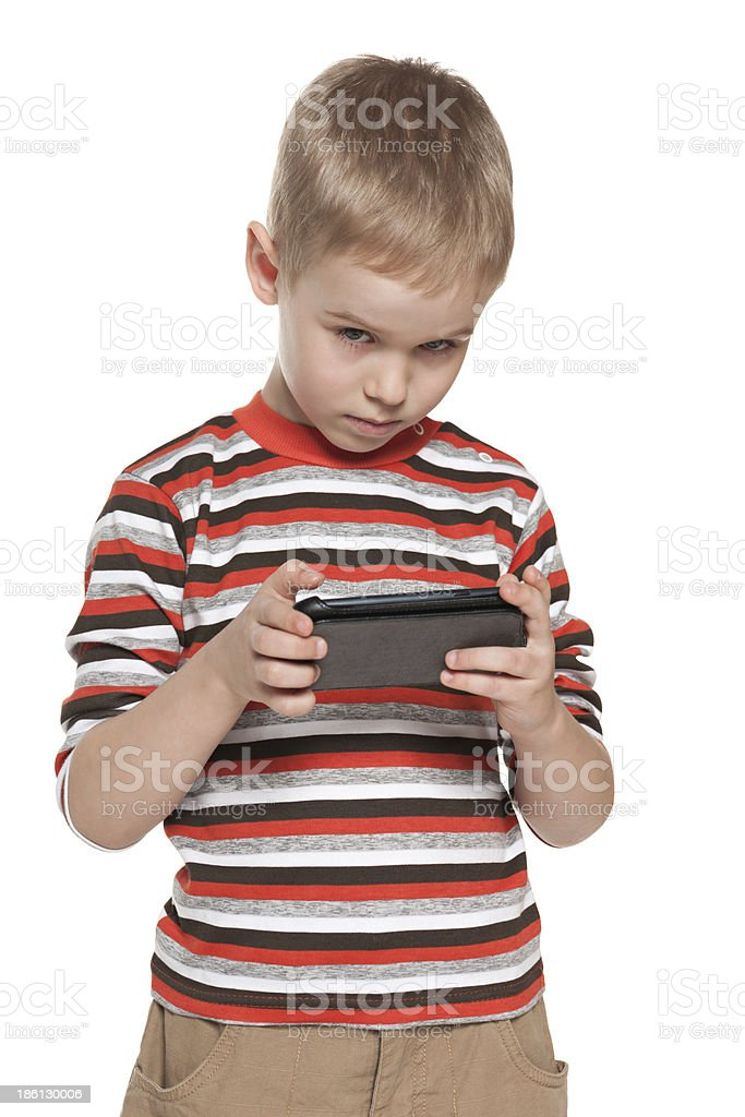 Young boy with a gadget stock photo