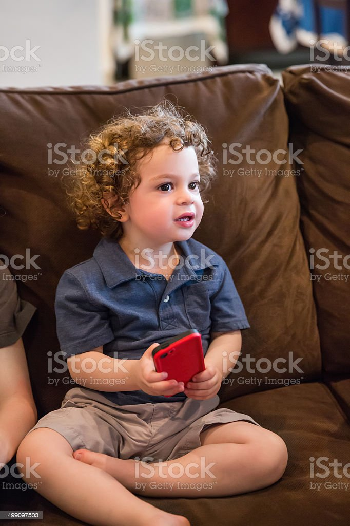Young boy with a smart phone royalty-free stock photo