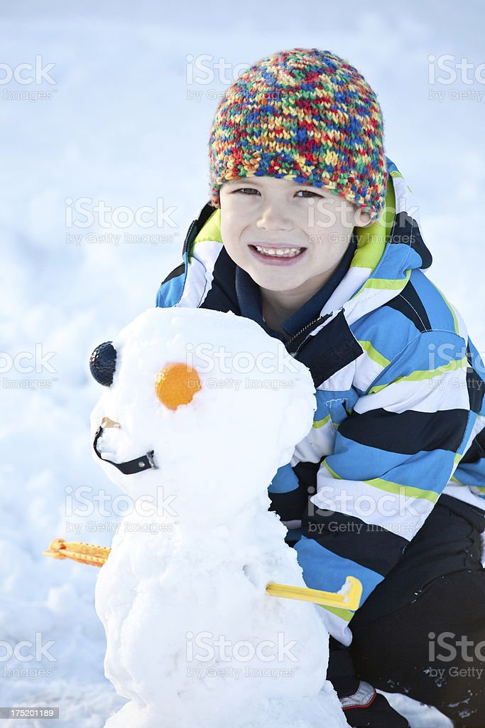 Young Boy With a Strange Snowman royalty-free stock photo