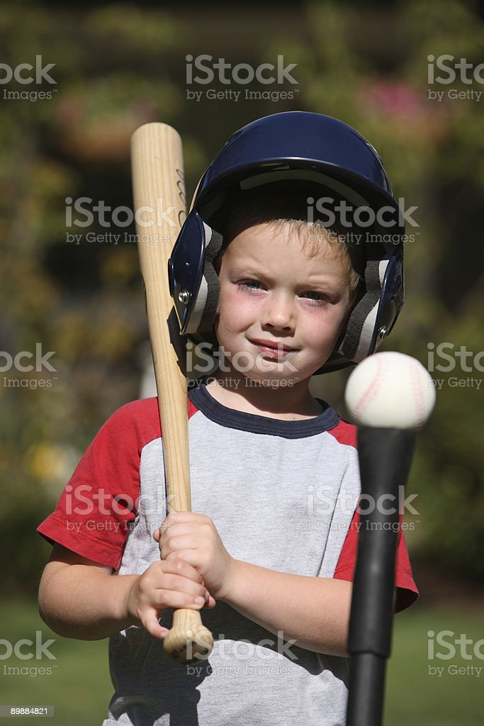 Young boy with baseball equipment stock photo