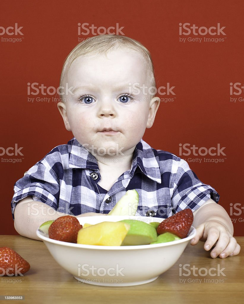 Young boy with bowl of fruit royalty-free stock photo