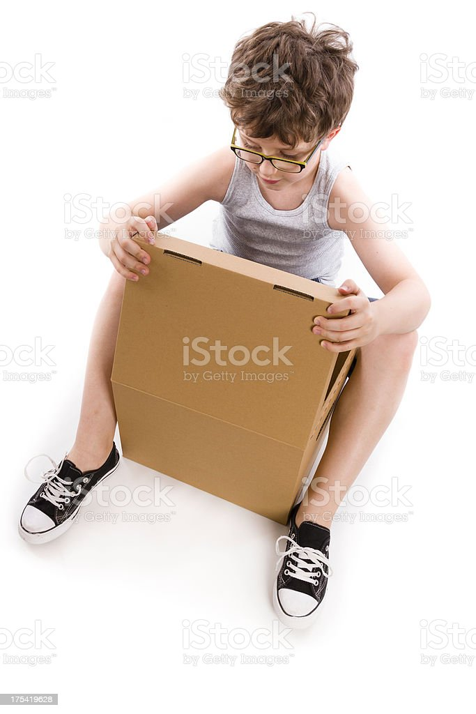 young boy with box royalty-free stock photo