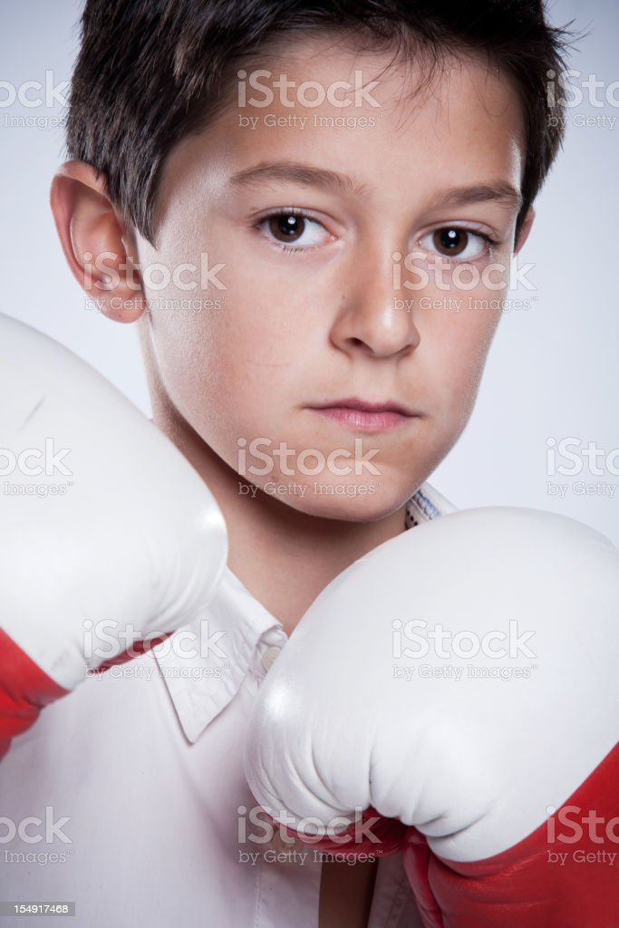 Young boy with boxing  gloves. royalty-free stock photo