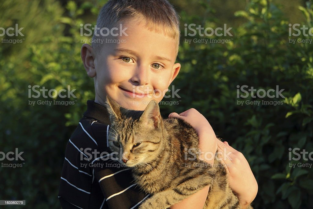 young boy with cat royalty-free stock photo
