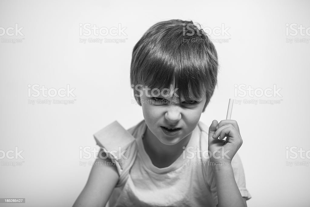 Young Boy with Cigarette in Hand, Sneering royalty-free stock photo