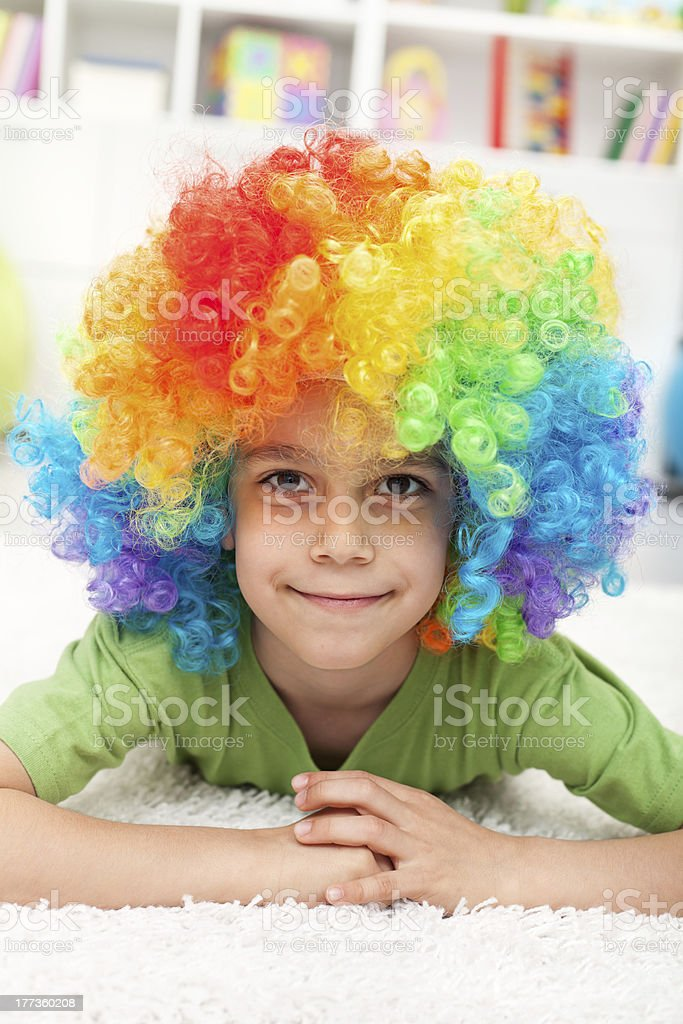 Young boy with clown wig royalty-free stock photo