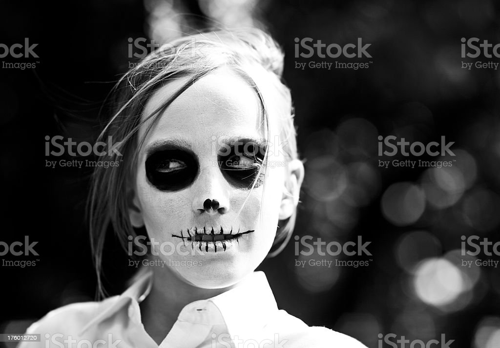 young boy with death make up on his laptop royalty-free stock photo