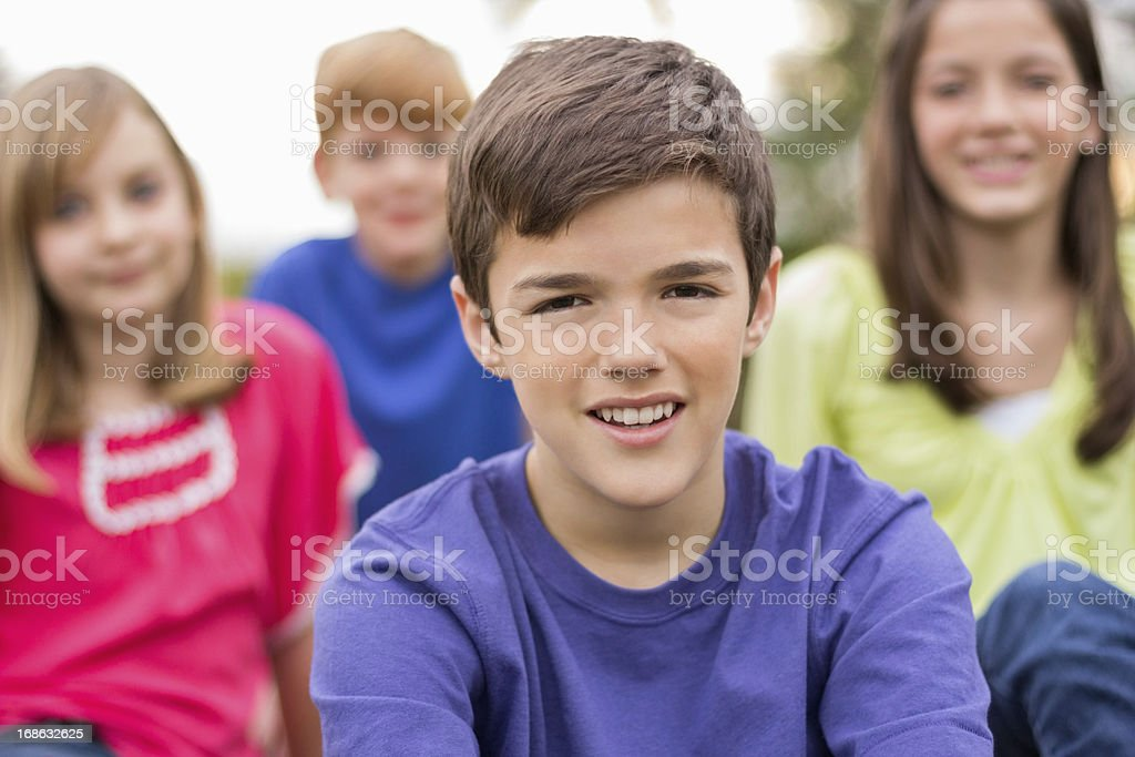 Young Boy With Friends In Background royalty-free stock photo