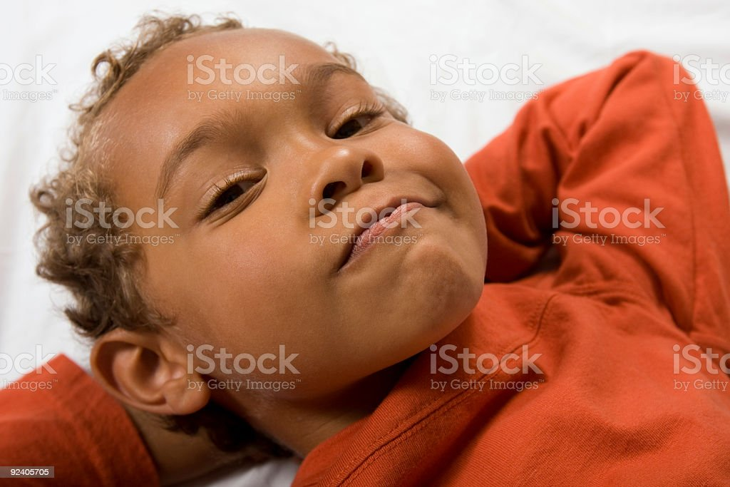 Young boy with grin looking at camera stock photo