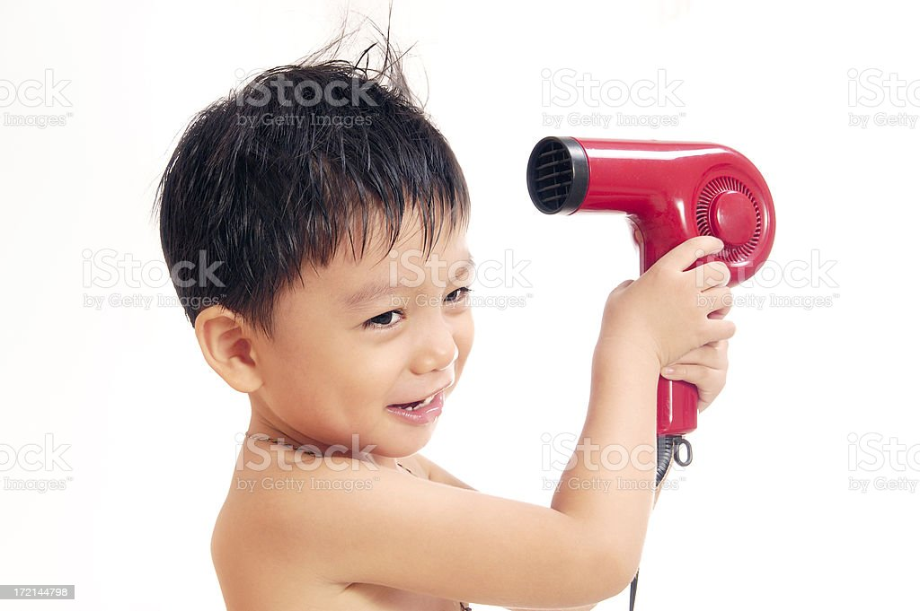 Young Boy With Hair Dryer royalty-free stock photo