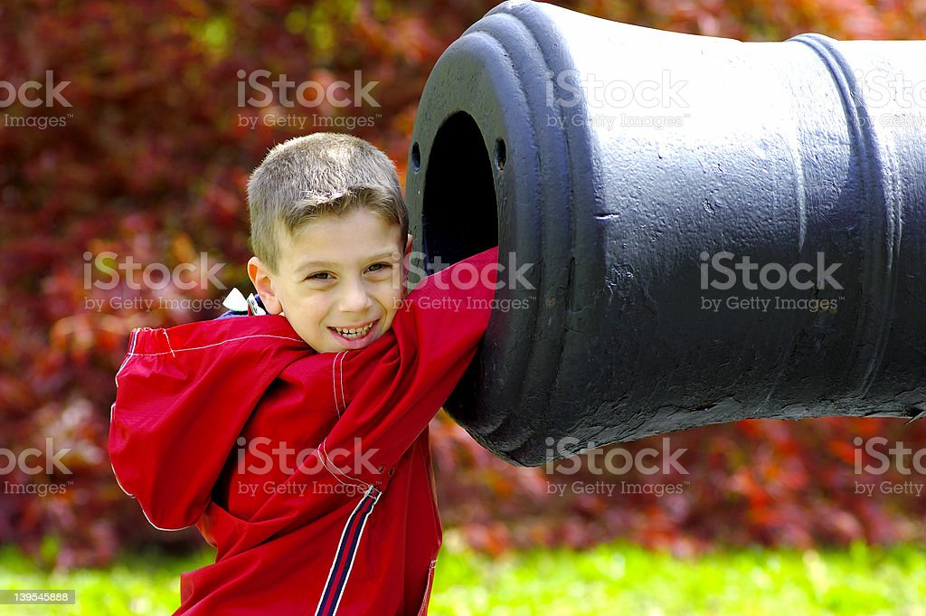 Young Boy WIth Hand In Cannon royalty-free stock photo
