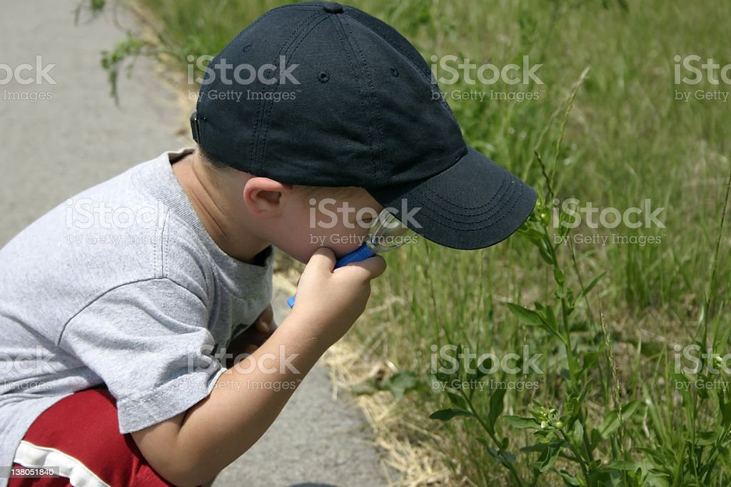 Young boy with magnifying glass royalty-free stock photo