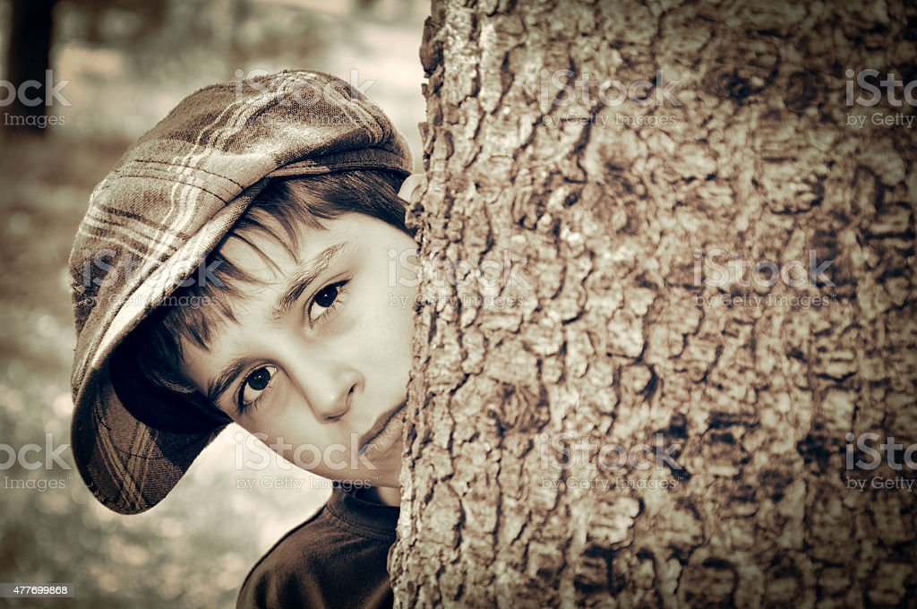 Young boy with newsboy cap playing detective stock photo