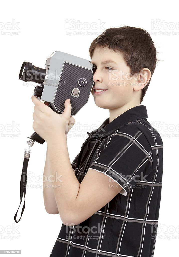 young boy with old vintage analog 8mm camera royalty-free stock photo