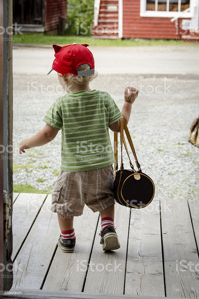 Young Boy with Purse stock photo