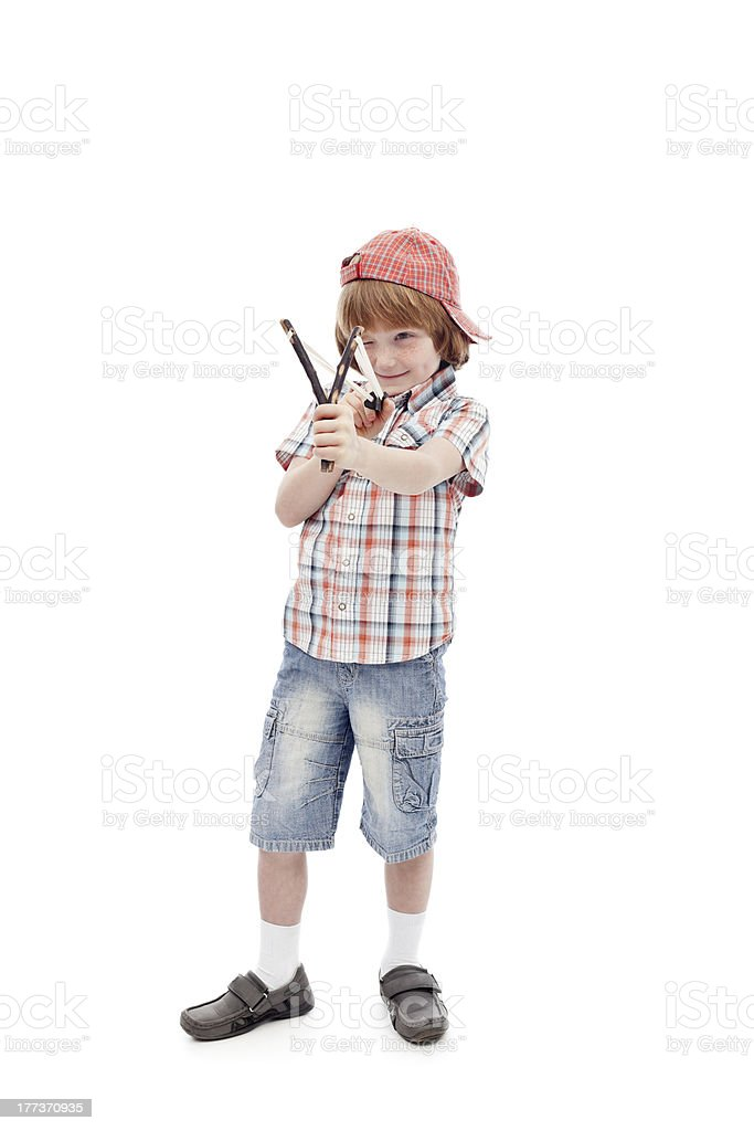 Young boy with sling aiming stock photo