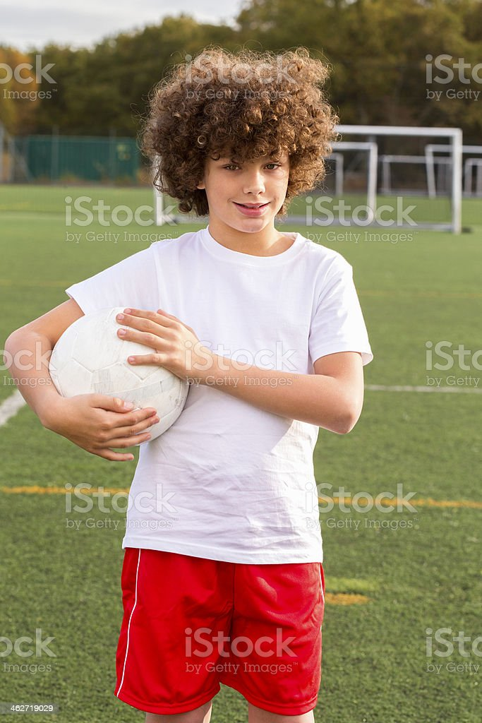 Young Boy With Soccer Ball royalty-free stock photo