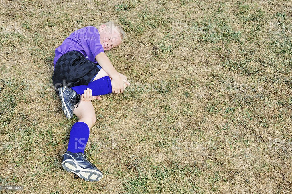 Young Boy with Soccer Injury royalty-free stock photo