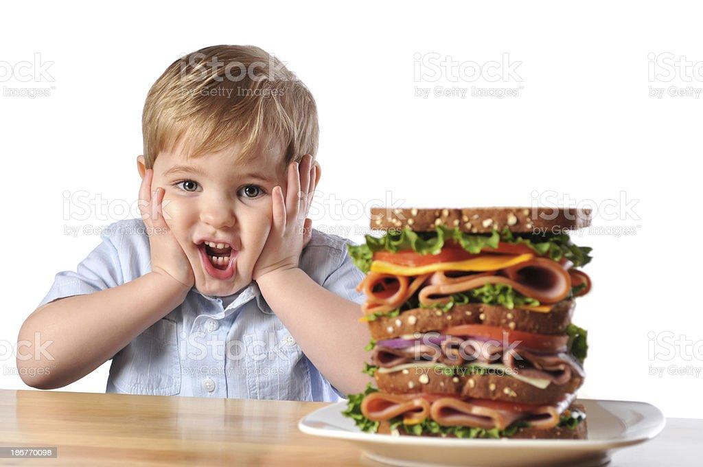 Young Boy with Triple Decker Dagwood Sandwich royalty-free stock photo