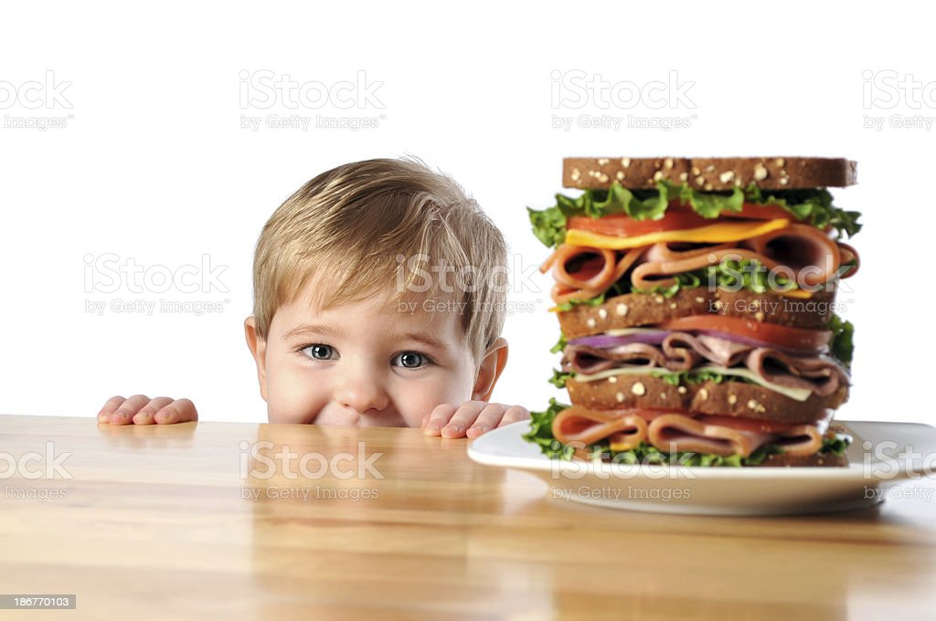 Young Boy with Triple Decker Dagwood Sandwich royalty-free stock photo