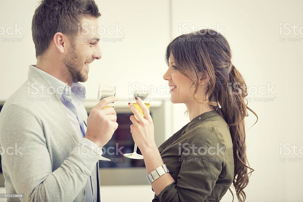 young boyfriends in the kitchen cheers royalty-free stock photo