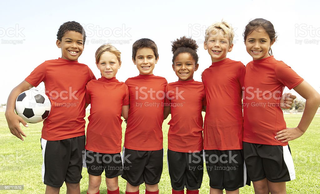Young Boys And Girls In Football Team royalty-free stock photo