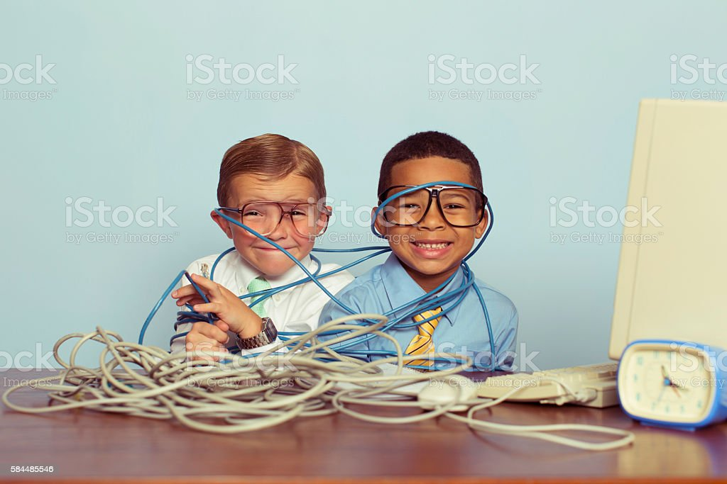 Young Boys and IT Professionals Smile at Computer Desk stock photo