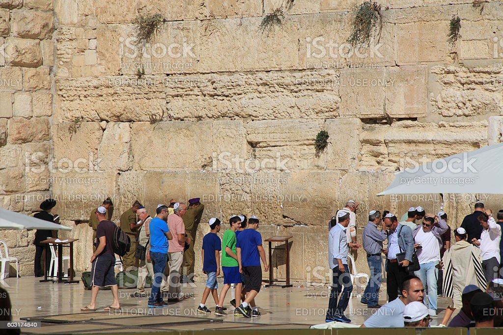 Young Boys and Other Jewish Men at the Wailing Wall stock photo