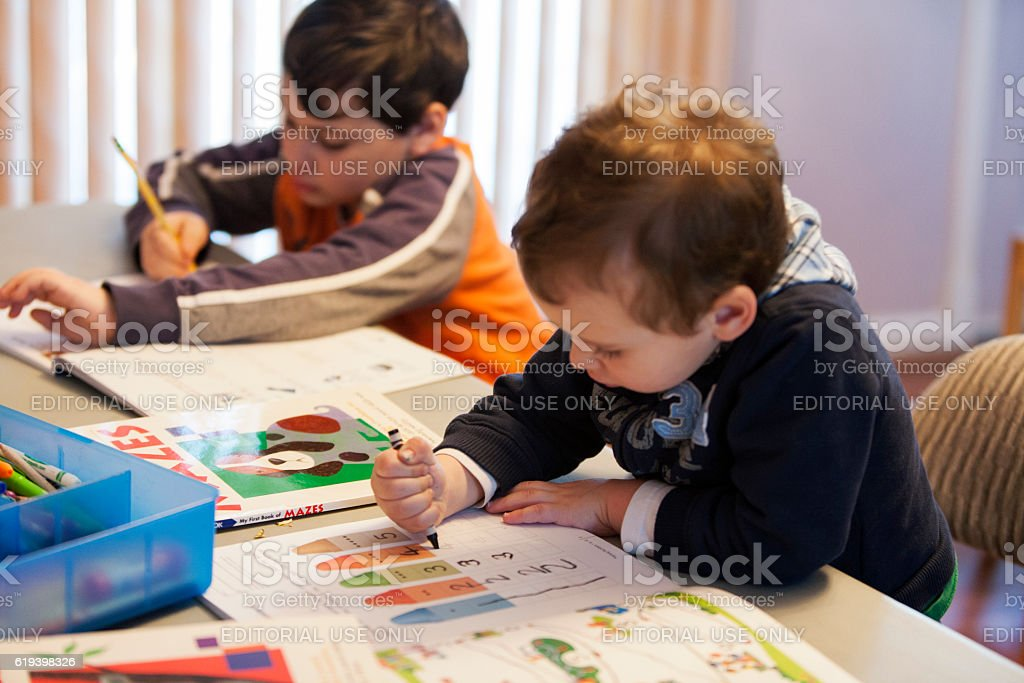 Young Boys Developing Good School Study Habits at Home stock photo