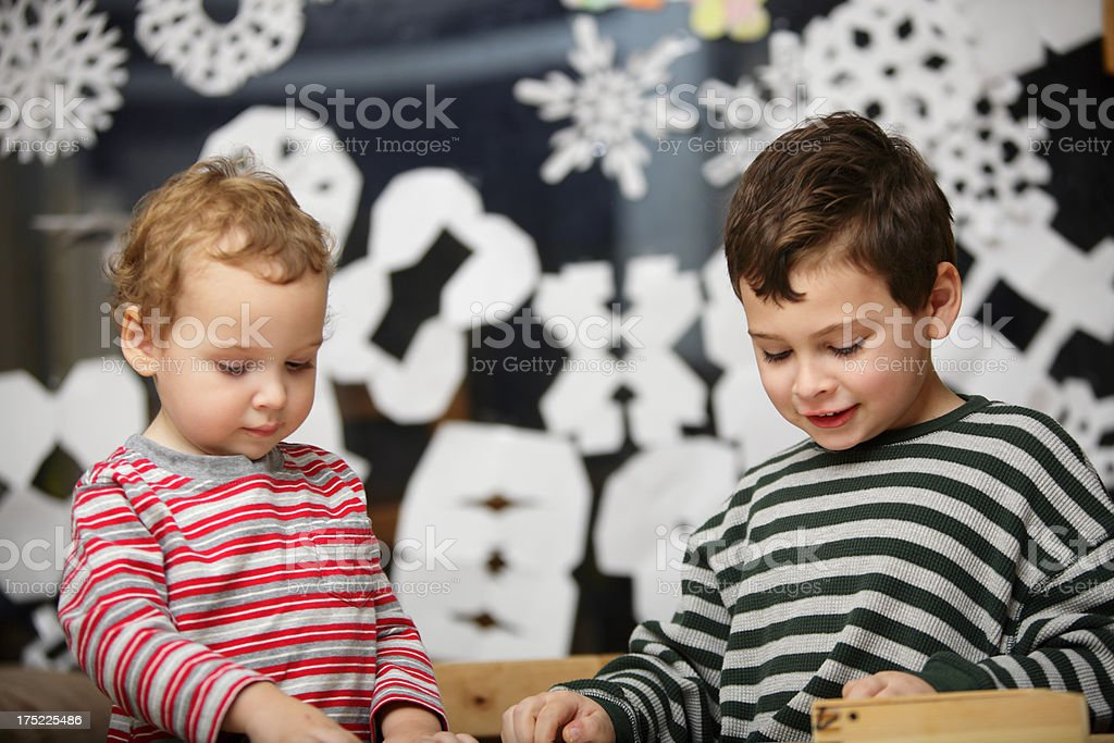 Young boys engaged in play during the holidays royalty-free stock photo