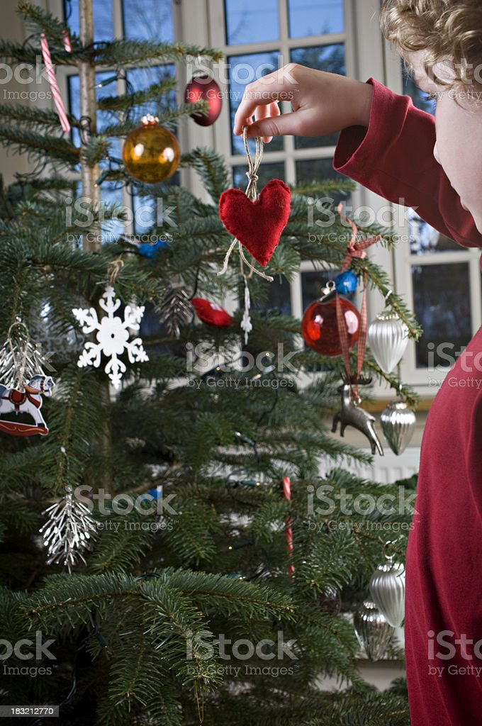 Young Boy's Hand Holding Heart Shaped Christmas Decoration. royalty-free stock photo