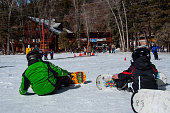 Young Boys learning how to Snowboard Ski Resort