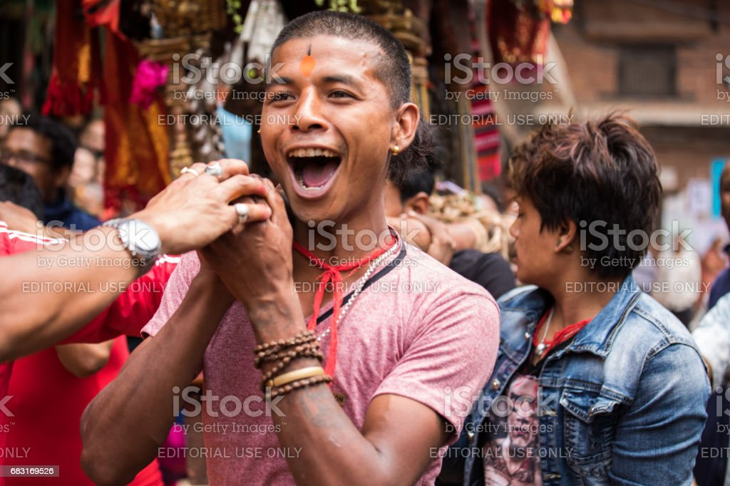 Young boys participating in a ceremonial procession. stock photo